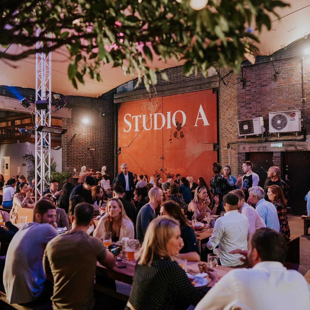 Capital studios, people drinking in the yard